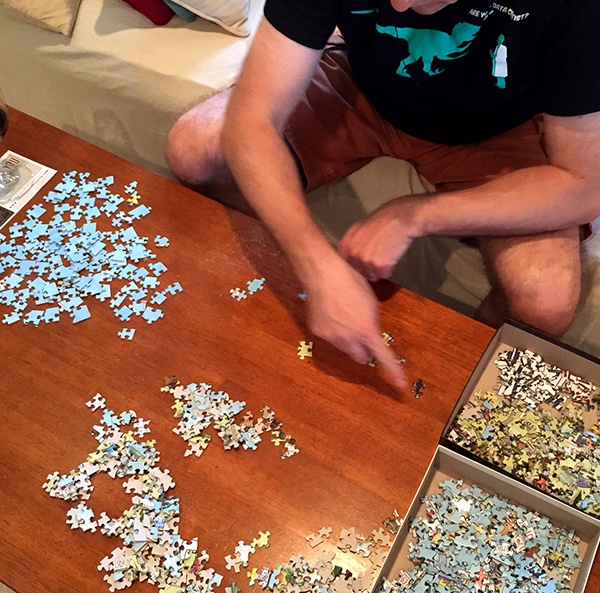 My Husband Sorting the Puzzle Pieces